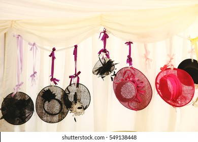 hanging hats at a wedding