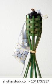hanging ketupat with bamboo pelita icon of hari raya.