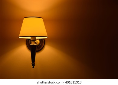 Hanging lamp lit wall in natural light
