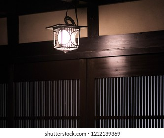 Hanging lamp outside a Japanese house at night.
