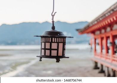 Hanging lantern of Itsukushima shrine, looking out to sea.