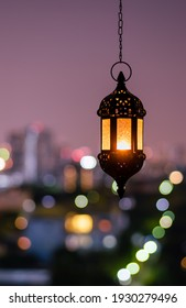 Hanging lantern with night sky and city bokeh light background for the Muslim feast of the holy month of Ramadan Kareem. - Shutterstock ID 1930279496