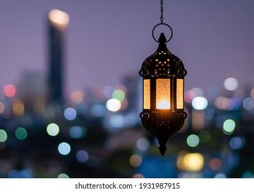 Hanging lantern with night sky and city bokeh light background for the Muslim feast of the holy month of Ramadan Kareem. - Shutterstock ID 1931987915