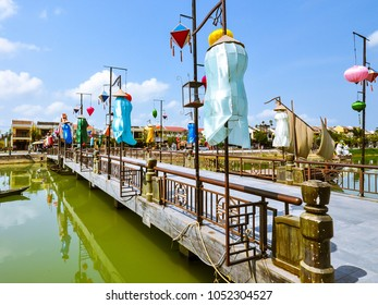 Hanging lanterns adorn Hoi An Bridge over the Thu Bon River - Hoi An, Vietnam