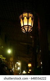 hanging Lanterns in a raw at night in street.