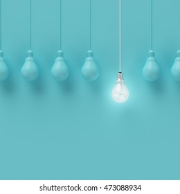 Hanging light bulbs with glowing one different idea on light blue background , Minimal concept idea , flat lay , top