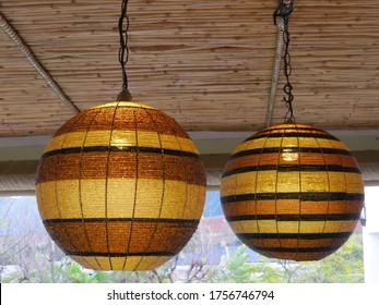 Hanging lights with brown and orange striped beaded shades