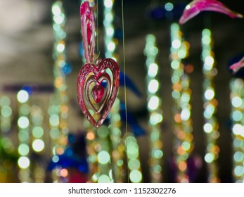 A hanging love shape object with illuminated lights unique blurry photo