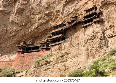 Hanging monastery temple suspended on long wooden poles near Datong, China, touristic spot in Shanxi Province