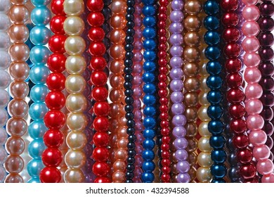 Hanging multi-colored beads on a string.