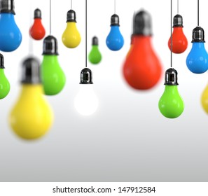 Hanging multicolored light bulb on bright background.