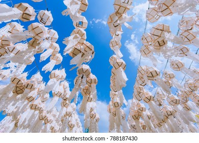 Hanging Northern Thai style lanterns and blue sky.They can see in Northern of Thailand. They are decorated in important festivals such as Loy Krathong Festival, songkran festival etc.