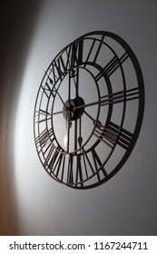 Hanging on the wall clock casts a mystical shadow