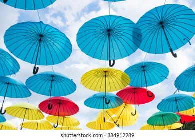 Hanging  opened colored umbrellas
