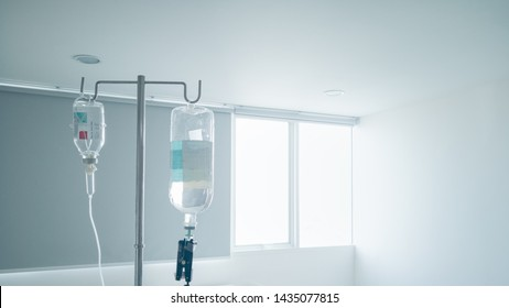 Hanging pillar and Saline solution fluid iv bag in emergency room at hospital.right copy space