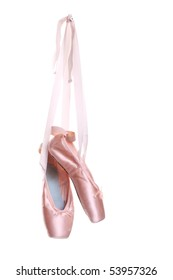 Hanging pink ballet shoes isolated on a white background