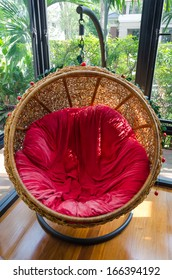 Hanging rattan chair in the house