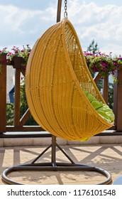 Hanging rattan swing chair
