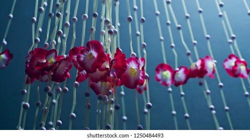 Hanging red decorative artificial flowers unique photo