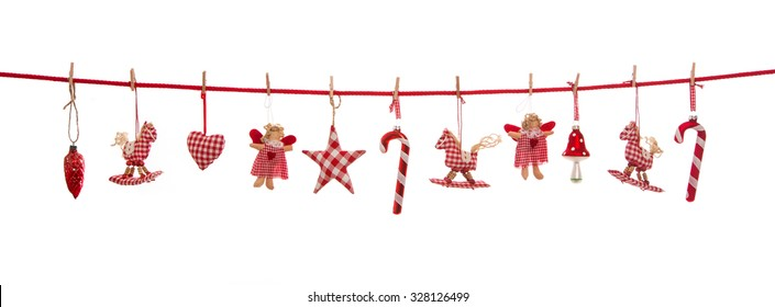 Hanging red white checked christmas decoration isolated on the background in country style.