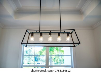 Hanging retro black metal iron chandelier lighting fixture with vintage bulbs