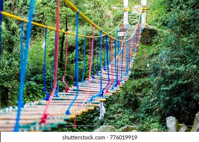 A hanging rope bridge over the waterfall in Panchpula Dalhousie, Himachal Pradesh, India. Used for adventure activities for kids and teenagers.
