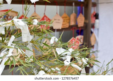 hanging tied of bad luck predict fortune paper ( Omikuji )