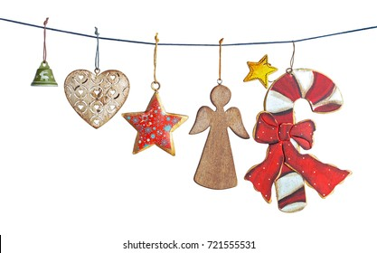 Hanging vintage Christmas decorations isolated on white background
