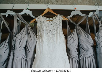 Hanging wedding dress and bridesmaids dresses
