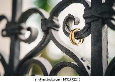 hanging wedding rings on railing