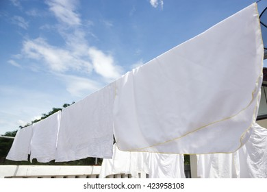 Hanging white diaper clothes laundry. Sunny day.