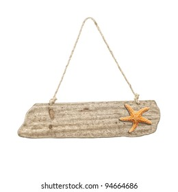 Hanging wooden sign with starfish - beach holiday concept