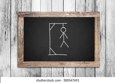 Hangman drawing on chalkboard.