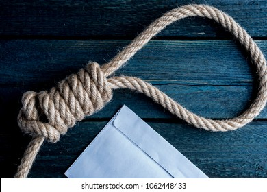 Hangman noose with letter of suicide
