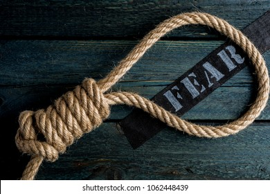 Hangman noose with letter of suicide anxious person