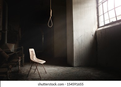Hangman Noose with thirteen loops setup in an abandoned building. Beautiful rays of light coming from the window.