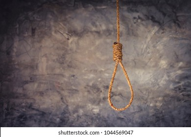 Hangman's Noose Knot over gray concrete wall background