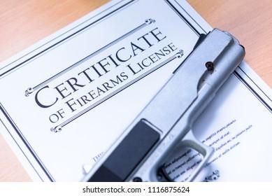 Hangun laying on a Gun / Firearms License Certificate