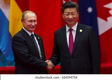 HANGZHOU, CHINA - SEPT. 4. 2016 - Chinese president Xi Jinping (R) welcomes Russian President Vladimir Putin (L) in G20 summit in Hangzhou.