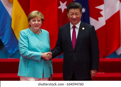 HANGZHOU, CHINA - SEPT. 4. 2016 - Chinese President Xi Jinping (R) welcomes German Chancellor Angela Merkel (L) in G20 summit in Hangzhou.