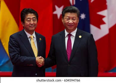 HANGZHOU, CHINA - SEPT. 4. 2016 - Chinese president Xi Jinping (R) welcomes Japanese Prime Minister Shinzo Abe (L) in G20 summit in Hangzhou.