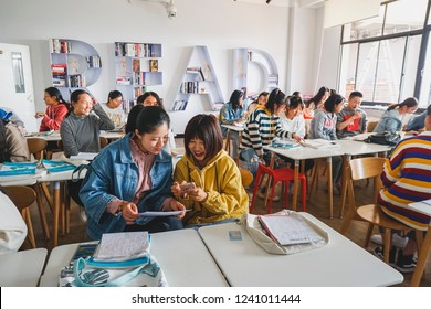 HangZhou Zhejiang Province China November 20th 2018 - Chinese students in classroom learning English and talking with each other.