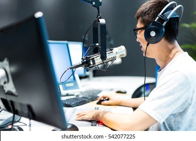 hangzhou,china:young man dj works in modern broadcast studio on Aug,17,2016