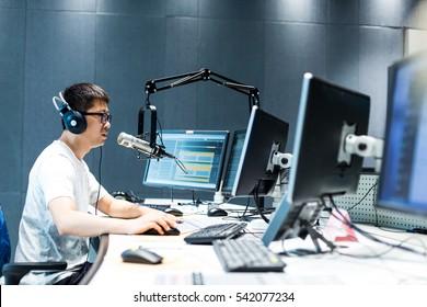 hangzhou,china:young man dj works in modern broadcast studio on Aug,17,2016