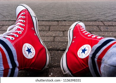 Hanley, Stoke on Trent, Staffordshire - 17th - July - 2018 - Pair of Red and White Converse All Stars, Chuck Taylors in the high street background
