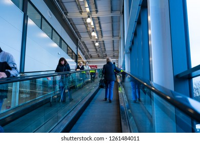 Hanley, Stoke on Trent, Staffordshire - 16th December 2018 - People ride the escalator at the large Sainsbury's store, shop, supermarket in Newcastle Under Lyme