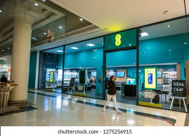 Hanley, Stoke on Trent, Staffordshire - 4th January 2019 - A lady on a mobile phone walks past the EE store in the Intu Potteries shopping centre, mall in the city centre