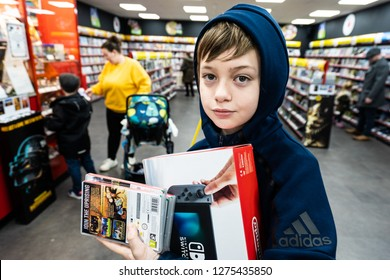 Hanley, Stoke on Trent, Staffordshire - 4th January 2019 - A young handsome boy with ADHD, Autism, Aspergers Syndrome trades in a Nintendo Switch in the CEX store, shop in Stafford town centre