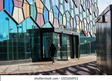 Hanley, Stoke on Trent, Staffordshire - 16th February 2019 - A man walks past One Smithfield the Stoke on Trent City Council offices in Hanley, the Potteries