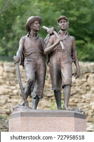 HANNIBAL, MISSOURI - AUGUST 14:  Bronze statue of Mark Twain's fictional characters, Tom Sawyer and Huckleberry Finn, on August 14, 2014 in Hannibal, Missouri